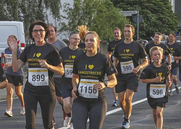 """Einzigartiges Team-Erlebnis: """"Gemeinsam starten, gemeinsam ankommen"""" lautet die Devise der Teilnehmer beim Opel-Firmenlauf."""